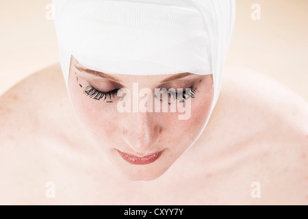 Woman before undergoing plastic surgery with markings on her face - Stock Photo