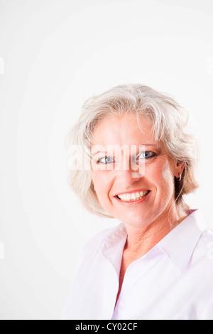 Smiling elderly woman, portrait - Stock Photo