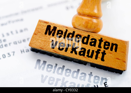 Rubber stamp with the wording 'Meldedaten verkauft', German for 'registration data, sold', symbolic image for a - Stock Photo
