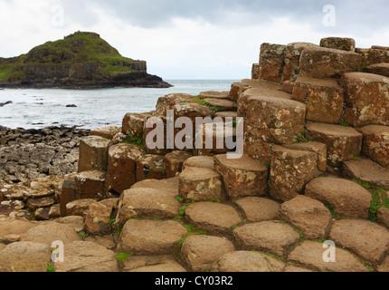 Polygonal basalt lava rock columns of the Giant's Causeway on the north coast of County Antrim, Northern Ireland, - Stock Photo