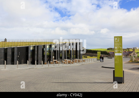 The new Giant's Causeway visitors centre building with grass roof and basalt columns. Antrim Northern Ireland UK - Stock Photo