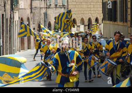 After the victory for their district, people in medieval costumes are moving through all districts, Palio, Siena, - Stock Photo