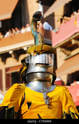 Knight's armour, people dressed in medieval costumes representing their respective city districts at the Palio - Stock Photo
