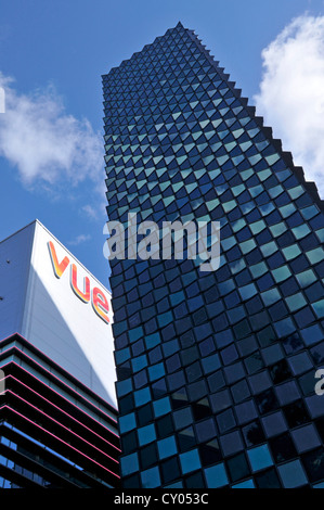 Architecture tower block and sunlit Vue cinema sign above outdoor shopping mall at the Stratford city Westfield - Stock Photo