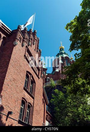 Uspenski Cathedral set upon a hillside on the Katajanokka peninsula overlooking the city of Helsinki, Finland - Stock Photo