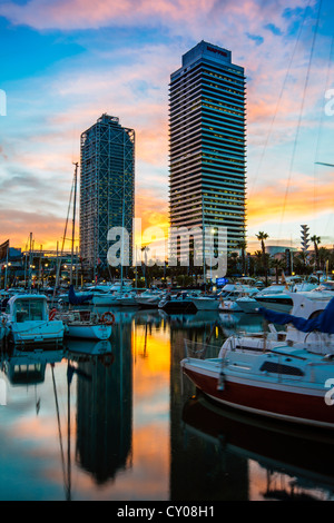 Sunset view over Port Olimpic with Hotel Arts and Mapfre Tower in the background, Barcelona, Catalonia, Spain - Stock Photo