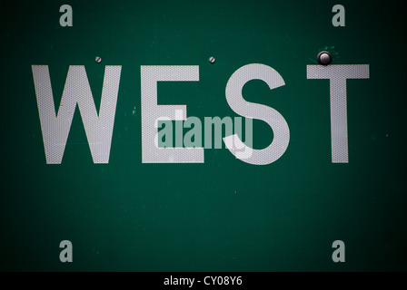 detailed close up of interstate road sign with the word 'west.' taken on interstate 40 east of albuquerque, new - Stock Photo