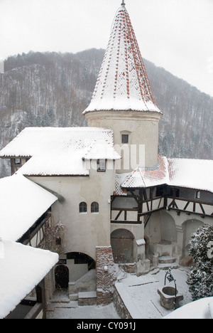 Romania. Transylvania. Bran. Bran Castle, aka Dracula's Castle from the 14th century. Tower covered in snow.
