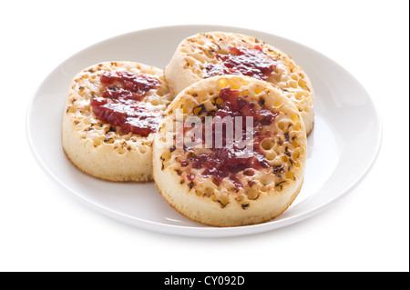 three english crumpets with butter and jam isolated on a white background - Stock Photo
