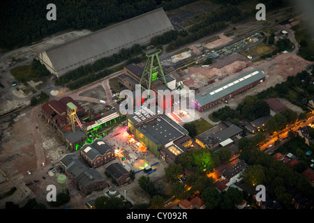 Aerial view, former colliery, lettering 'Was bleibt ist Zukunft', German for 'what remains is the future', headframe - Stock Photo