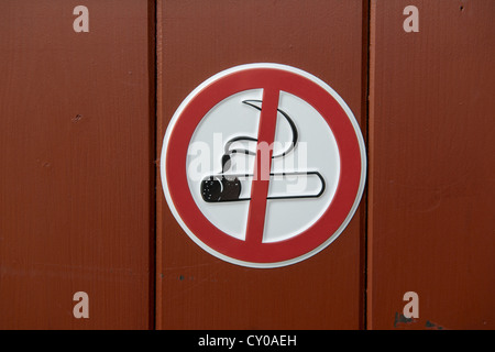 No smoking sign, on a wooden door - Stock Photo