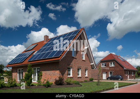 Housing development, multi-family house with solar and hot water system on the roof, solar heat, East Frisia, Lower - Stock Photo