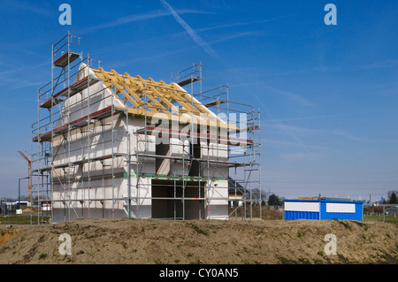House construction site, building shell surrounded with scaffolding, Erftkreis district, North Rhine-Westphalia, - Stock Photo