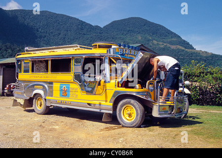 Mini-bus created from a Jeepney, one of the old jeeps left behind by the Americans when they withdrew from the Philippines - Stock Photo