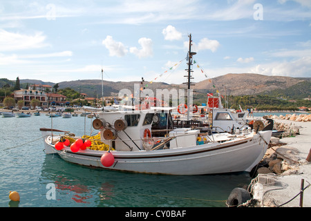 Small fishing boats in harbour between ilheu de sal rei for Fishing boat dealers near me