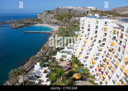 View of the Anfi del Mar resort and Playa de la Verga beach as seen from Aquamarina hotel, near Arguineguin, Gran - Stock Photo
