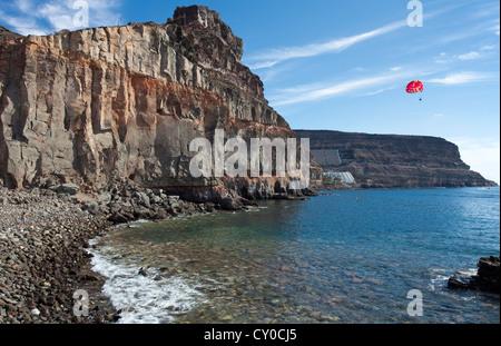 Rocky coast near Puerto de Mogan, Gran Canaria, Canary Islands, Spain, Europe, Atlantic Ocean - Stock Photo