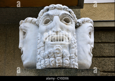 Masks in front of the Festival Hall by the Austrian sculptor Jakob Adlhart, 1898-1985, Salzburg, Salzburg province, - Stock Photo