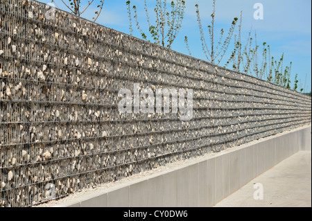 Noise barrier at a supermarket in Eckental, Middle Franconia, Bavaria - Stock Photo