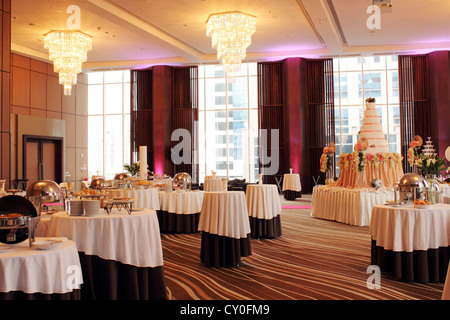 Beautiful ballroom decorated with set for a wedding party - Stock Photo