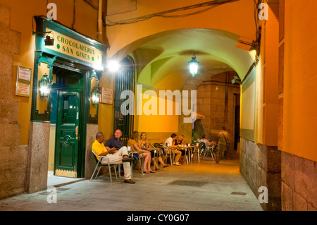 People sitting on terrace at evening. San Gines passage, Madrid, Spain. - Stock Photo
