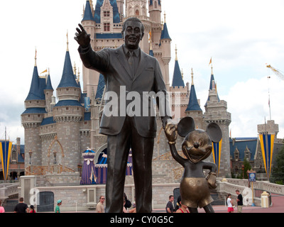 partners statue of walt disney and mickey mouse in front of cinderllas castle in the magic kingdom walt disney world - Stock Photo