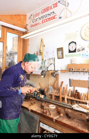 Julian Goodacre Bagpipe maker in Peeples Scotland, using a chisel on his wood lathe, - Stock Photo