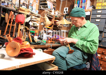 Julian Goodacre Bagpipe maker in Peeples Scotland, working on a set of pipes. - Stock Photo