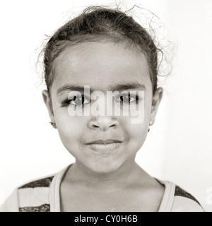 Portrait Of A Young Bedouin Girl In Black And White, Ibra, Oman - Stock Photo