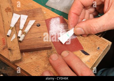 Julian Goodacre Bagpipe maker in Peeples Scotland,working a set of reeds - Stock Photo