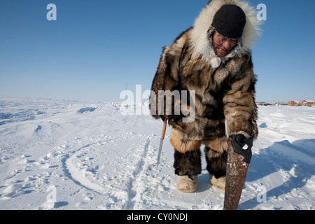 building an iglo on the north pole - Stock Photo