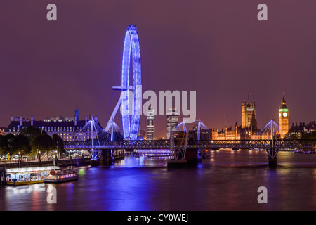 View of Houses of Parliament and the London Eye from Waterloo Bridge, London, England, Europe - Stock Photo