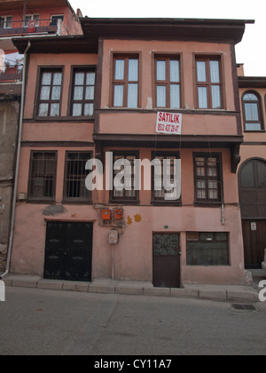 Streets in the Tophane district of Bursa Turkey, traditional house for sale - Stock Photo
