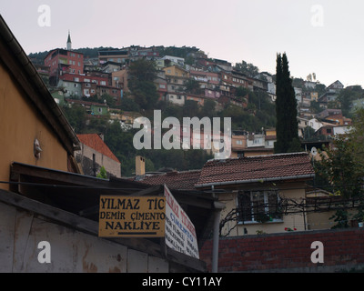 Streets and dwellings in the Tophane district of Bursa Turkey, long uphill to get home - Stock Photo