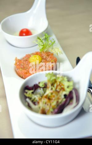 Tuna dish with tomato tartare and lettuce - Stock Photo