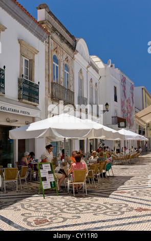 Portugal, the Algarve, street cafe in Faro town with decorative pavement - Stock Photo