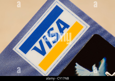 Visa logo sign in close up by hologram on plain background - Stock Photo