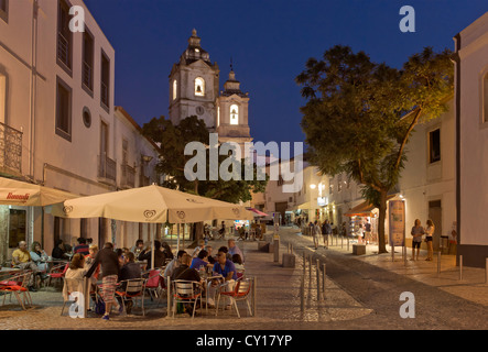 Portugal, the Algarve, Lagos, a street scene at dusk with the church of Santo Antonio - Stock Photo
