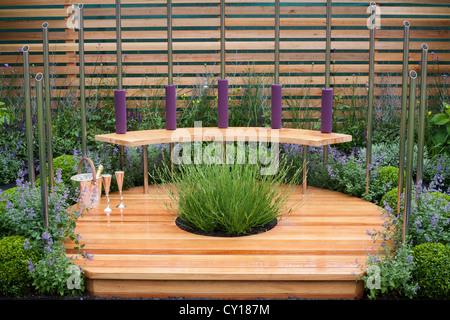 Relaxing area in contemporary designed garden. - Stock Photo