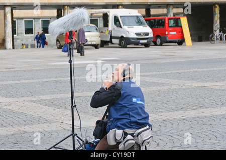 """Sound engineer from the German public television station broadcaster WDR with microphone on stand and """"dead cat"""" - Stock Photo"""