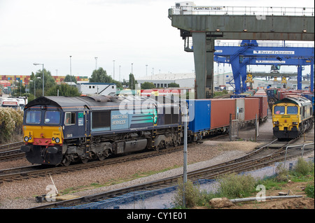 DRS (Direct Rail Services) freight train pulling out of the North rail-freight terminal, Port of Felixstowe, Suffolk, - Stock Photo