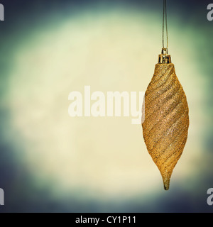 gold fir cone christmas bauble - Stock Photo