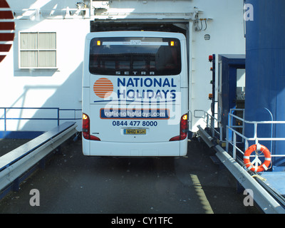 National Express Tour Bus boarding the Sea-Cat ferry Service at Dun-Laoghaire vehicle terminal in Dublin in Eastern - Stock Photo