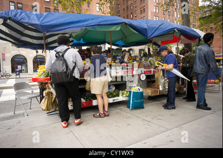 A fruit and vegetable stand in the Chelsea neighborhood of New York on Monday, October 15, 2012. (© Richard B. Levine) - Stock Photo