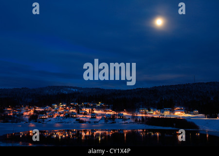 There are lights in every window in this Swedish village at Christmas time. - Stock Photo