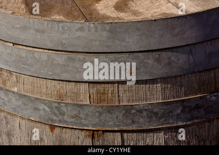 Detail of an old rusty wooden barrel of liquor. Shallow focus. - Stock Photo