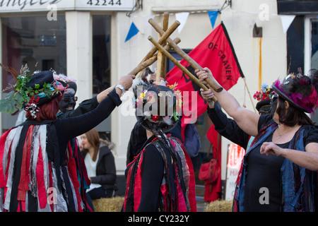 The Flagcrackers of Craven  Black Faced Morris or Folk Dancers at Ingleton Folk Festival in October 2012 - Stock Photo