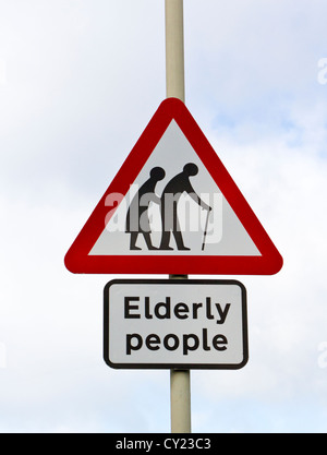 Road traffic warning sign indicating elderly people in the area - Stock Photo