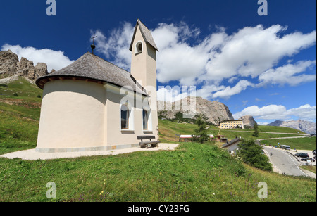 small chapel beneath Cir Dolomites in Gardena pass, Italy - Stock Photo