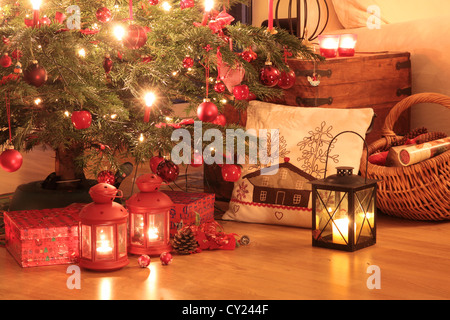 Christmas gifts in red under the Christmas tree - Stock Photo